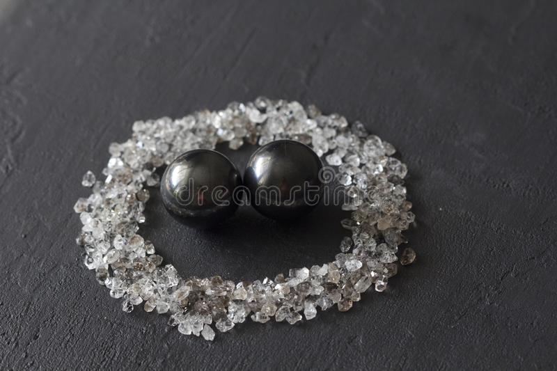 Scattered diamonds on a black background. Raw diamonds and mining, a scattering of natural diamond stones. Graphite quartz. Natural stones and minerals. Stone stock photos