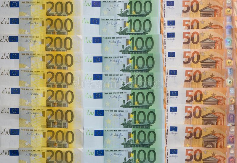 Scattered 200 euro, 100 euro, 50 euro banknotes, European currency - background. royalty free stock photo