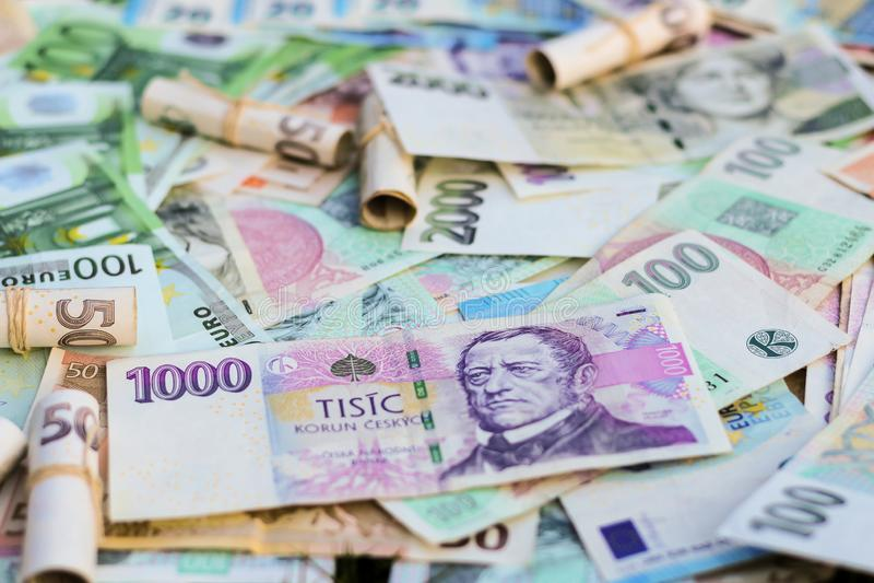 Scattered Euro and Czech Koruna bills royalty free stock photo