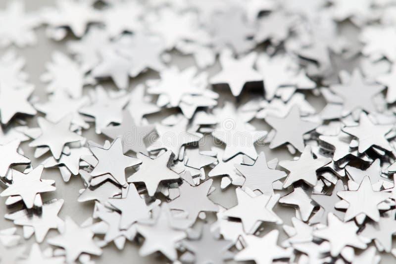 Scattered glittering stars confetti stock photo