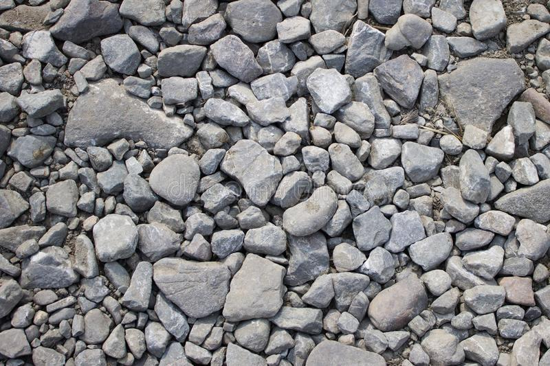 Scattered gray stones stock images