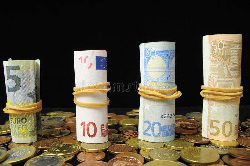 Scattered Money. Some Scattered Money Representing Different Markets Financial Concept stock photo