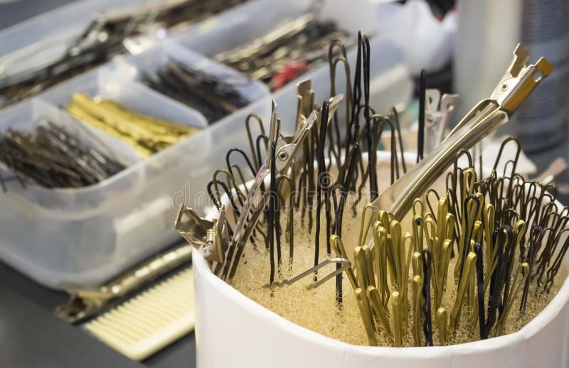 Scattered pins on a workplace of the hairdresser. stock image