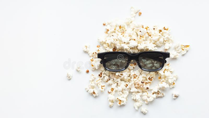Scattered popcorn and 3D glasses on white background. mock up. top view royalty free stock photo