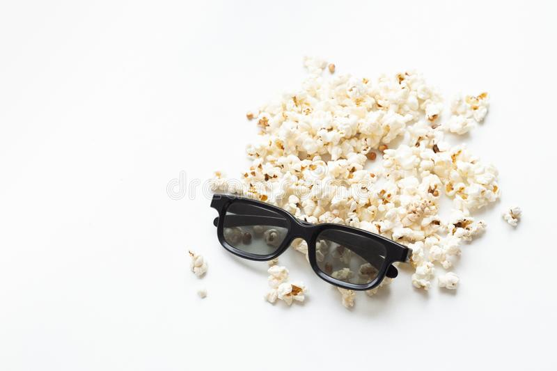 Scattered popcorn and 3D glasses on white background. mock up. top view stock photography