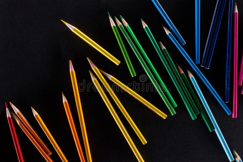 Scattered sharpened color pencils isolated on black. Scattered sharpened color pencils isolated on black,stock photo stock images