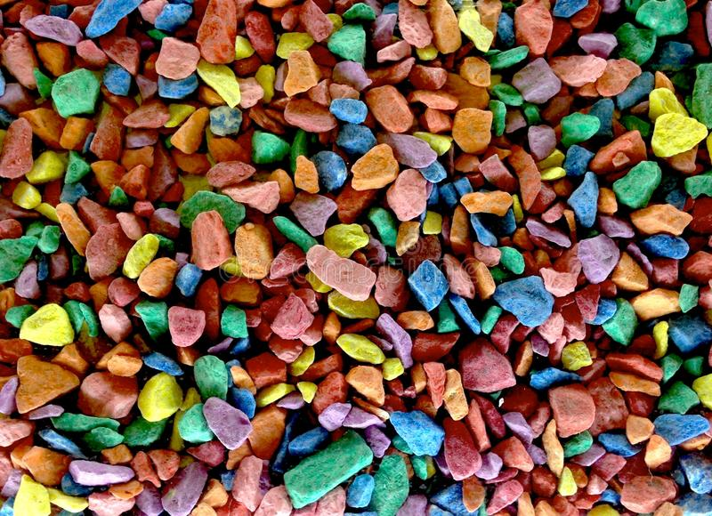 Scattered small bright colored stones royalty free stock image