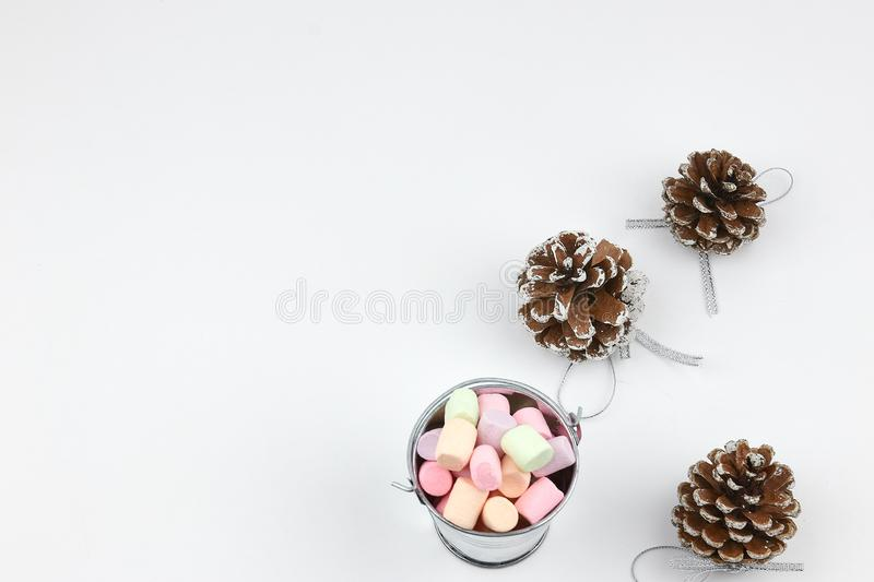 A stack of shortbread cookies with different types of nuts to a delicious coffee or tea on a dark wood table. horizontal view. stock image