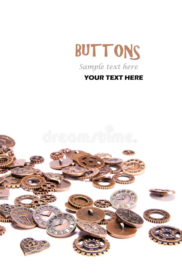 Scattered vintage copper metal buttons on a white background, shaped as gears, hearts, and clock pieces. Steam Punk. Gears clocks, cogs, buttons, wheels, watch royalty free stock images