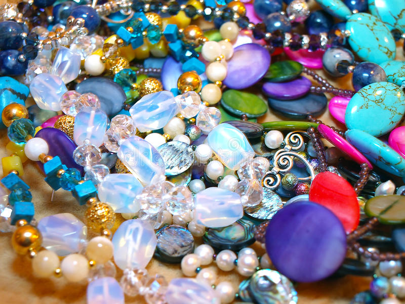 Scattering beads of semiprecious stones royalty free stock photography