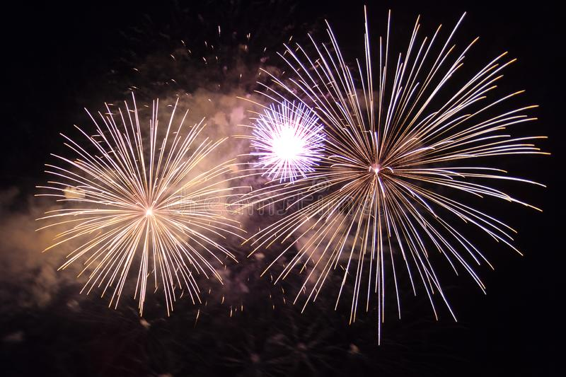 A scattering of festive fireworks in the night sky. Horizontal photo stock photo