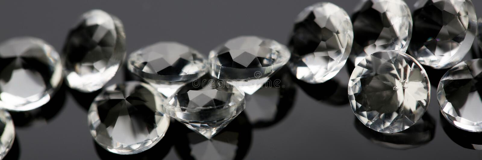 Scattering of white star diamonds on black. Background table jeweler concept stock photo