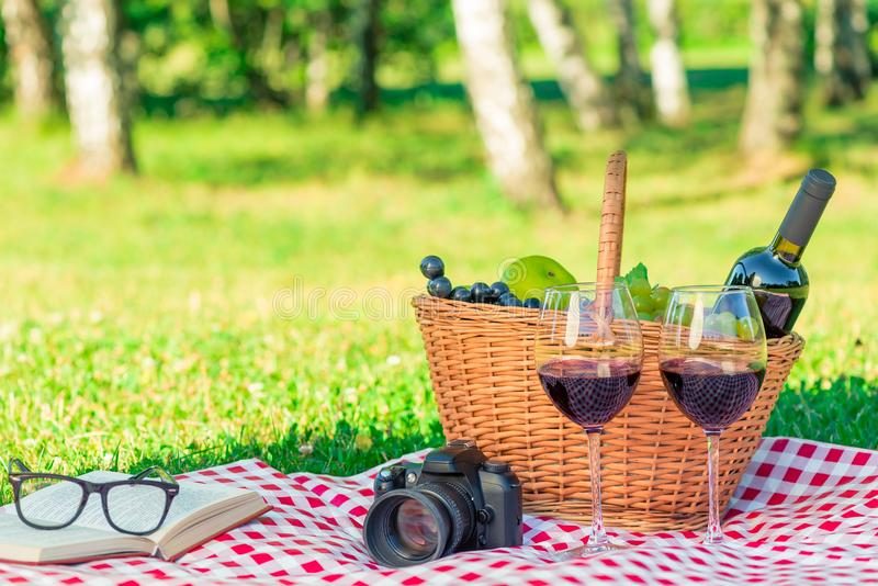on a scattern in a summer park objects for a picnic and a pleasant time, there are no people stock photography