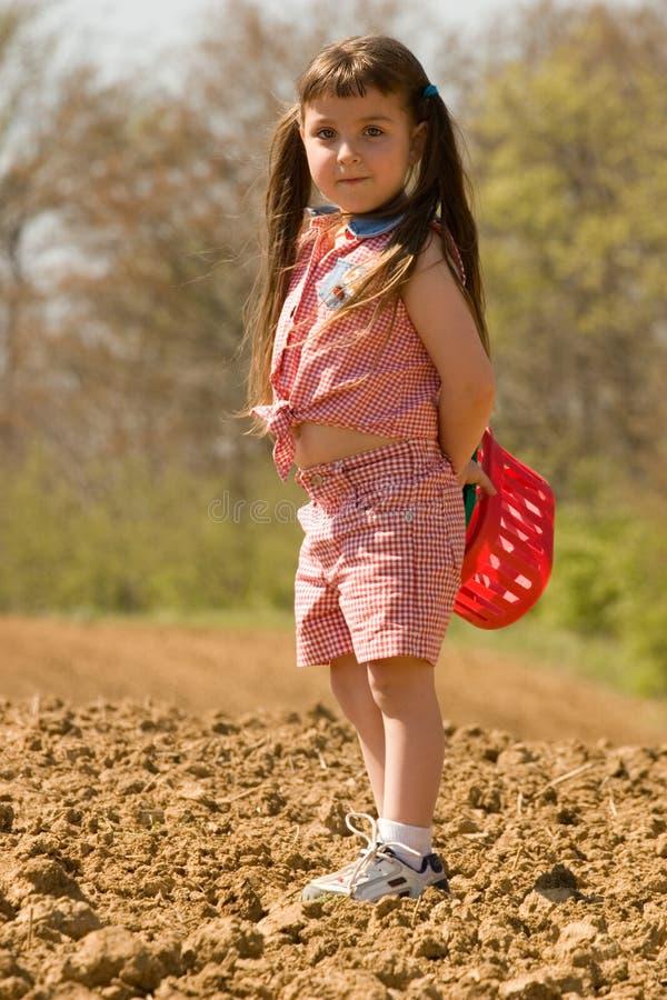 scavenger för flickajaktpigtail arkivfoto