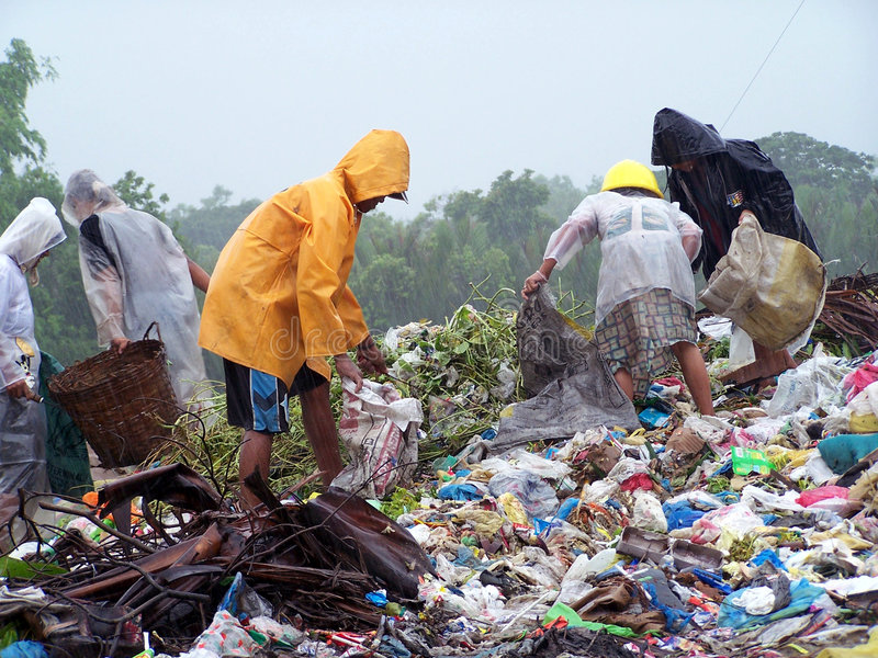 Scavengers. At dumpsite royalty free stock images