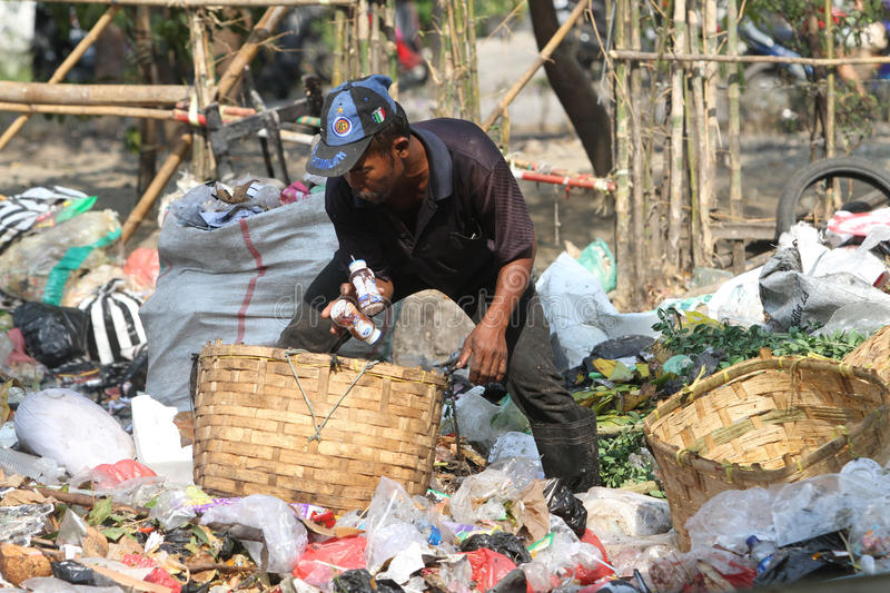 Scavengers. Pick trash at a garbage dump in the city of Solo, Central Java, Indonesia royalty free stock image