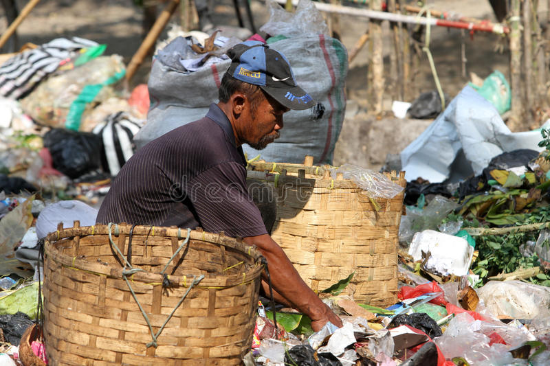 Scavengers. Pick trash at a garbage dump in the city of Solo, Central Java, Indonesia royalty free stock photos