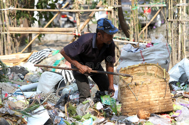 Scavengers. Pick trash at a garbage dump in the city of Solo, Central Java, Indonesia royalty free stock photography
