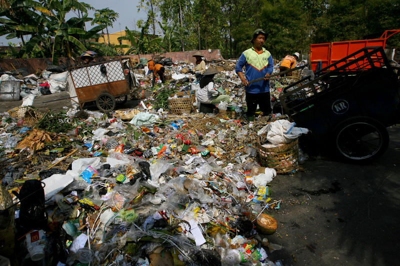 Scavengers. Sorting garbage in landfills in the city of Solo, Central Java, Indonesia stock photography