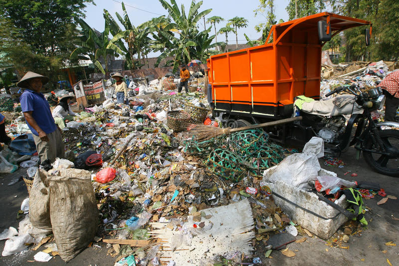 Scavengers. Sorting garbage in landfills in the city of Solo, Central Java, Indonesia royalty free stock photo