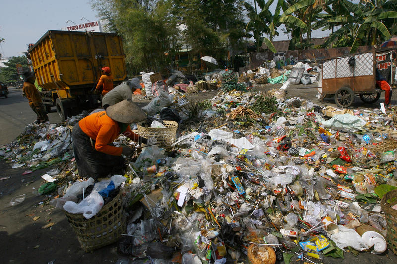Scavengers. Sorting garbage in landfills in the city of Solo, Central Java, Indonesia stock image