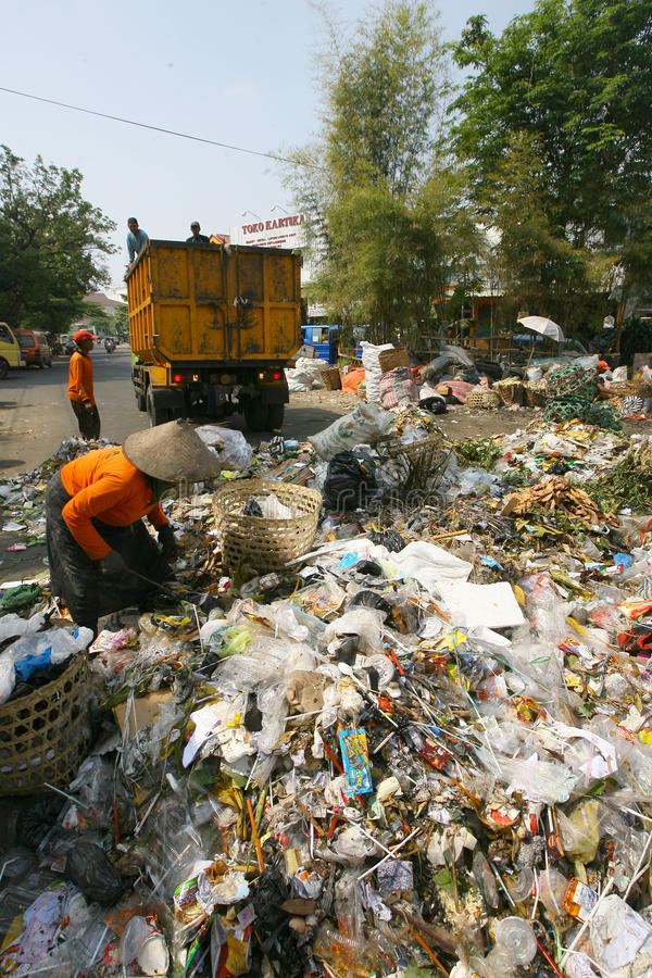 Scavengers. Sorting garbage in landfills in the city of Solo, Central Java, Indonesia stock photo