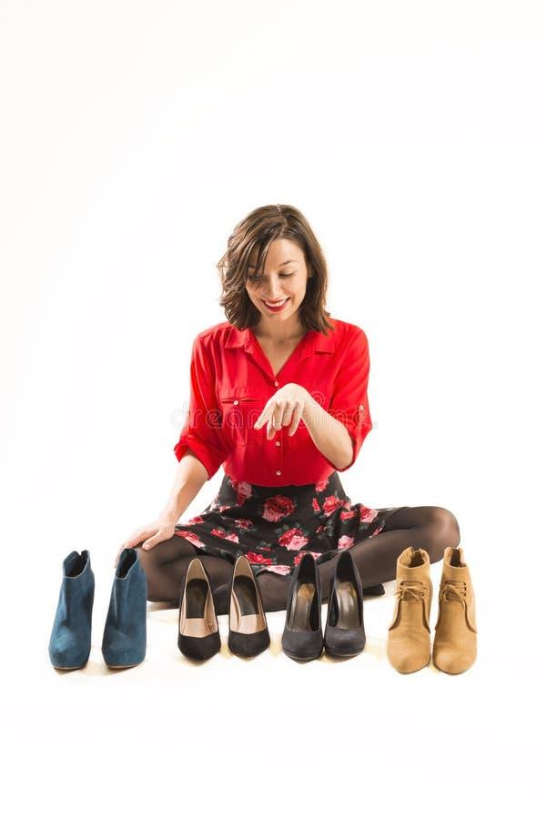 Scelta delle paia delle scarpe perfette fotografia stock