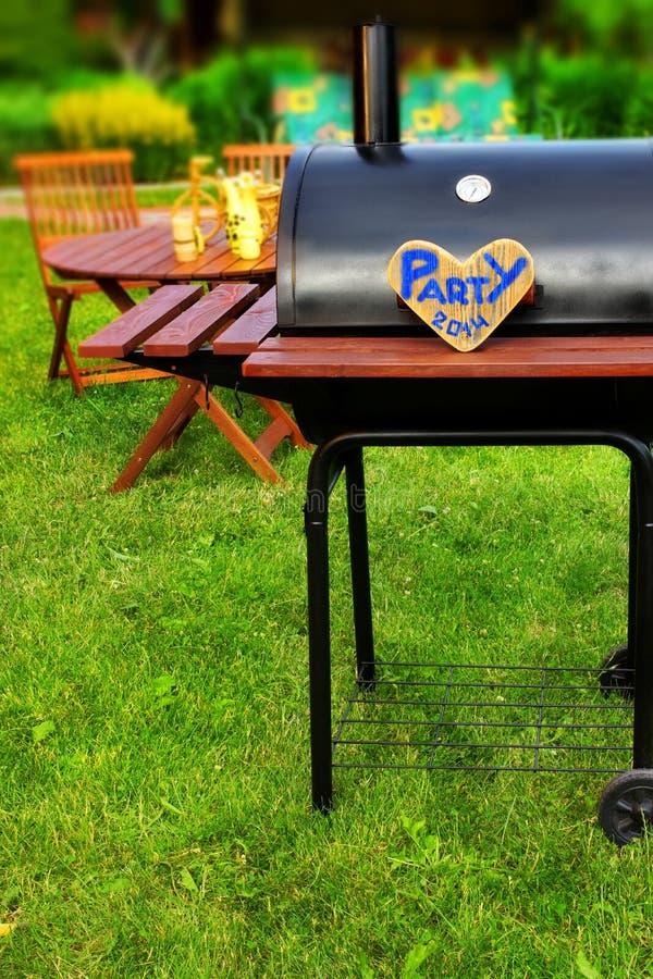 Scena del ricevimento all'aperto di estate del BBQ immagine stock libera da diritti