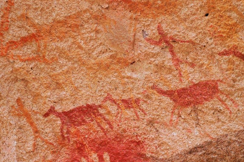 Scena di caccia nelle pitture di caverna antiche immagine stock