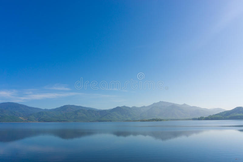 Scence of Reservoir and mountain. Blue sky nature background royalty free stock image