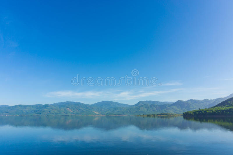 Scence of Reservoir and mountain. Blue sky nature background stock photos