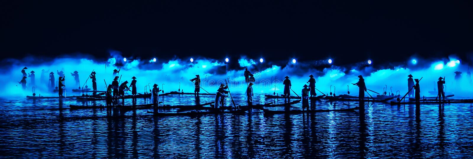A scene with actors on bamboo rafts. Part of the light show in Yangshuo stock photography