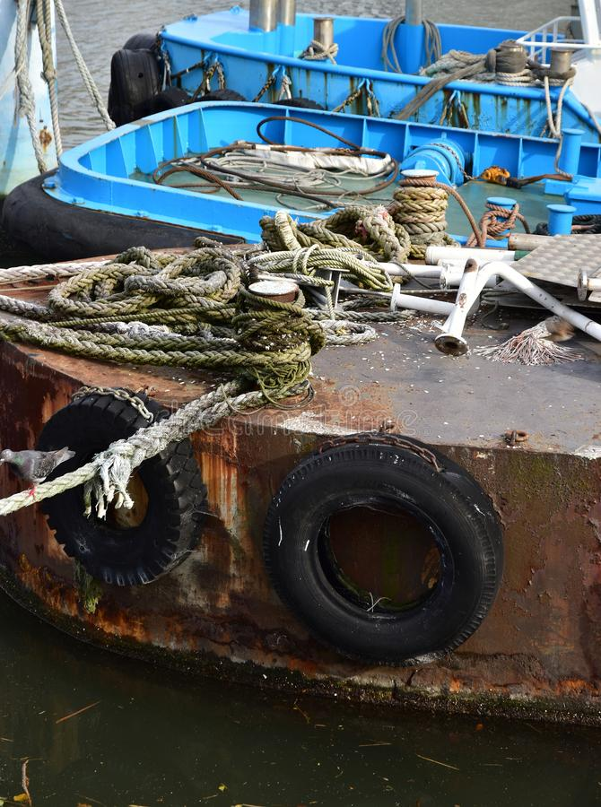 Scene of the anchoring ship. Scene of the old ship anchoring in the port stock images
