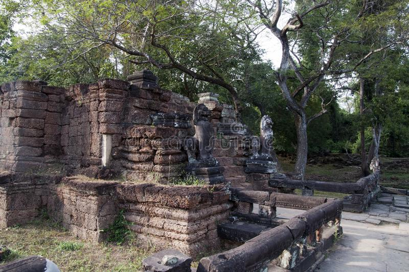 Stone lions guarding steps at the 12th century Preah Khan temple complex royalty free stock photo