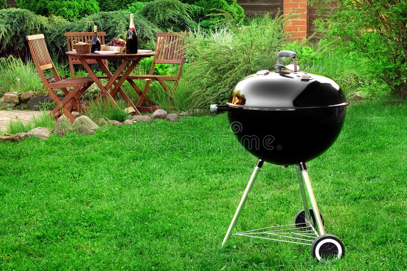 Scene Of Barbecue Grill Party On Lawn In The Backyard royalty free stock image