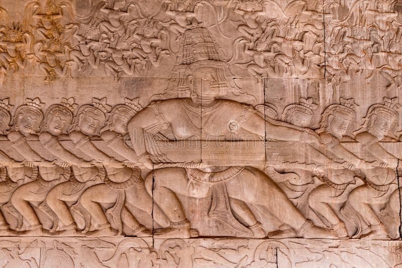 Scene of the Churning of the Milk Ocean carvings status on the w. All of Angkor wat temple, world heritage, Siemreap, Cambodia stock photography