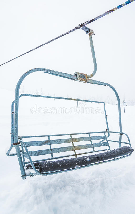 Scene Of Close Up Ski Lift With Seats Going Over The Snow Mountain ...