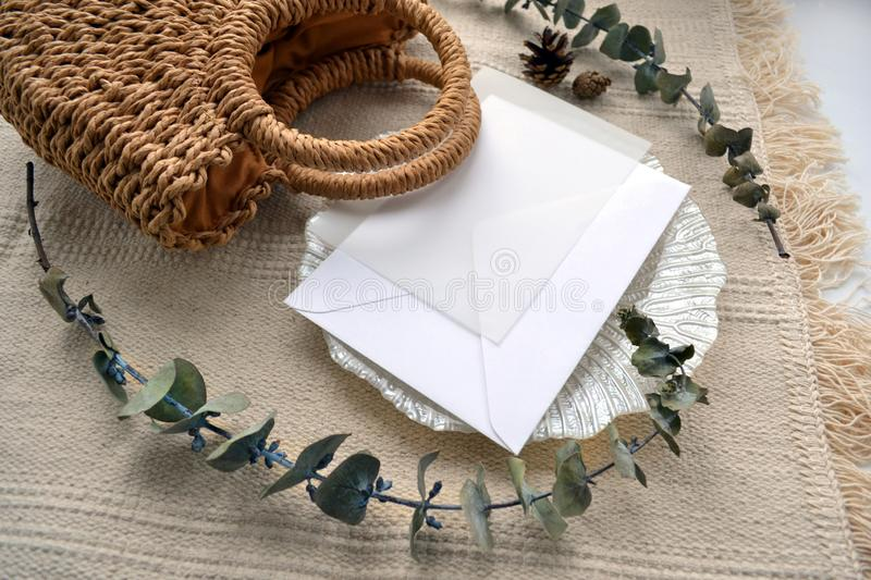 Scene envelope with calque, cone, woven straw bag royalty free stock photo