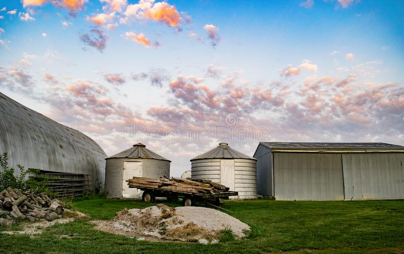Farm Outbuildings Framed by the Morning Clouds royalty free stock images
