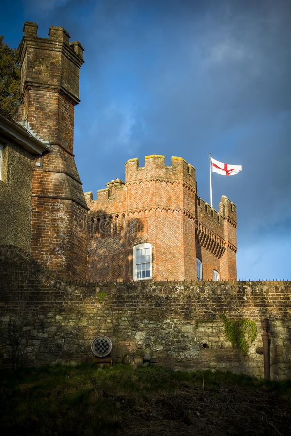 England flag fluttering above English castle in Surrey royalty free stock photos