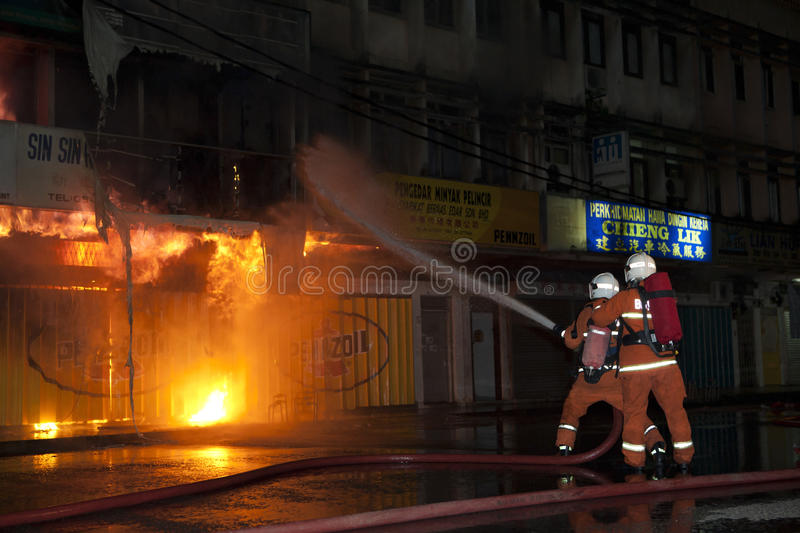 The scene of the fire. Malaysia, Pahang,mentakab, March 13 A fire the night of March 13, 2011 scene firemen are fighting royalty free stock photo