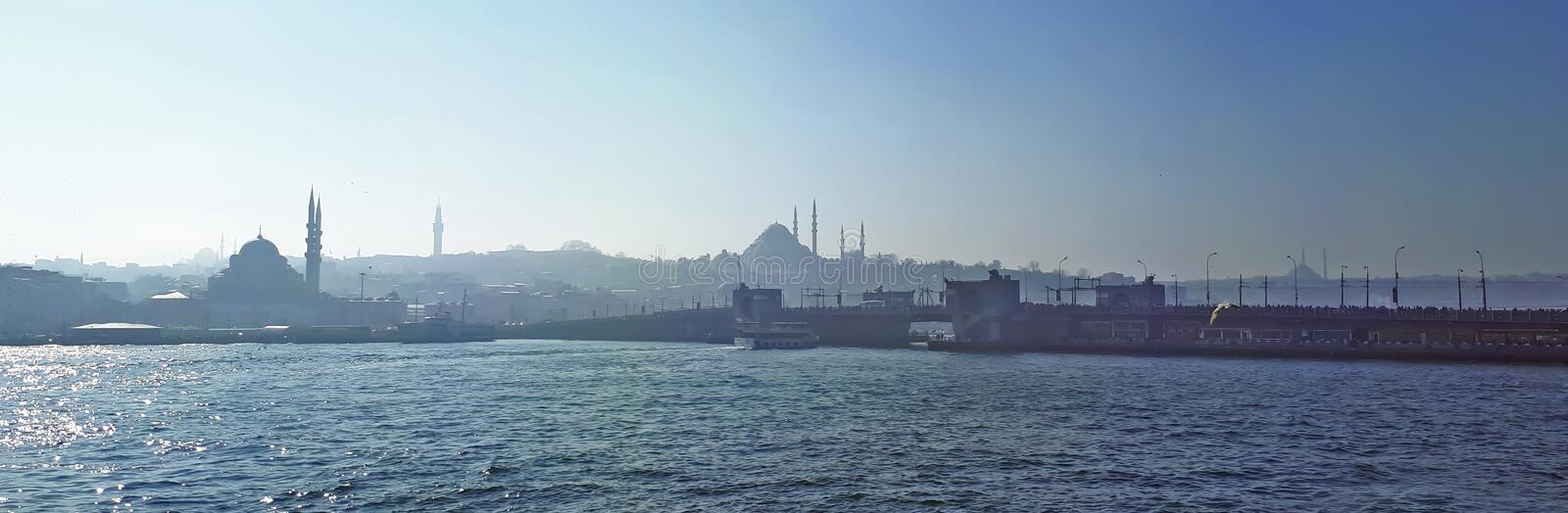 Istanbul mosques and galata bridge silhoutte stock photo
