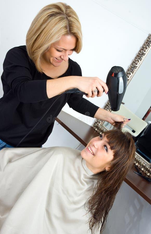 Scene in hair salon royalty free stock photos