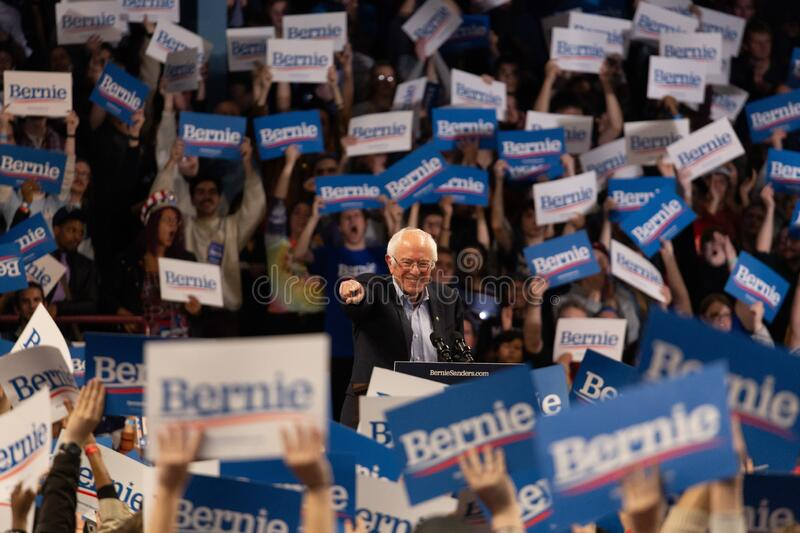 Scene from the heated rally of Bernie Sanders with the crowd holding banners actively cheering. MINNEAPOLIS, UNITED STATES - Nov 03, 2019: A scene from the stock images