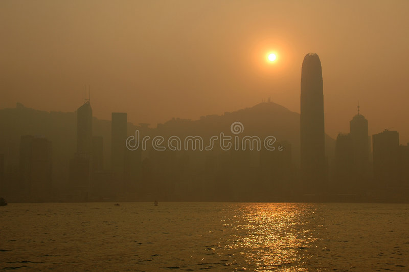 Scene - Hong Kong. The Hong Kong island view at sunset. A beautiful orange scene stock photo