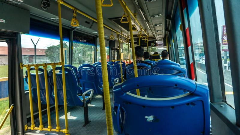 The scene inside of the SMART Selangor bus in the afternoon after leaving the KTM Sungai Buloh bus stop. Sungai Buloh, Malaysia - November 14, 2019: The scene stock photography