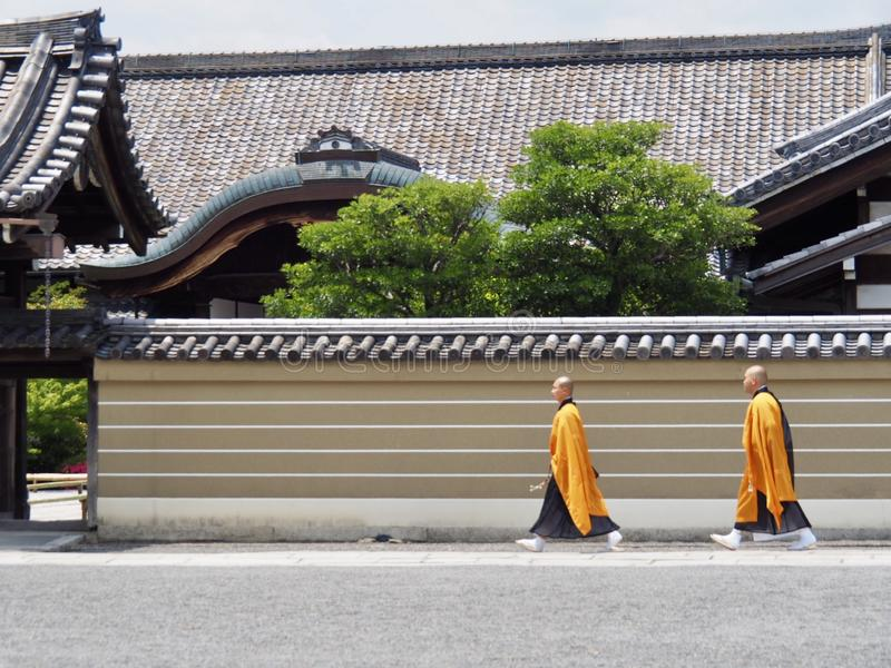 Two Monks Walking stock images
