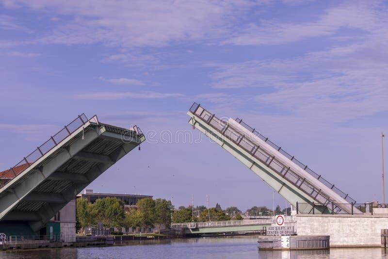Manitowoc,WI,USA August 31, 2019 :  lifting drawbridge over Manitowoc river. Scene from Manitowoc,WI royalty free stock photography