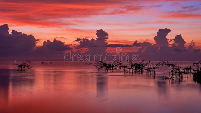 Scene of morning sky at Pakpra village, Phatthalung, Thailand. Scene of beautiful morning sky and giant square dipnet at Pakpra village, Phatthalung, Thailand royalty free stock photography