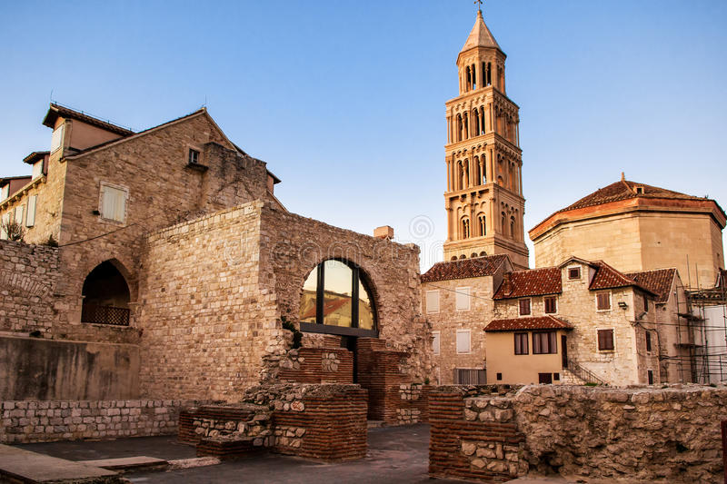 Scene from the old city of Split and the view of old bell tower. Scene from the old city of Split, Croatia and the view of old bell tower in sunset royalty free stock photos